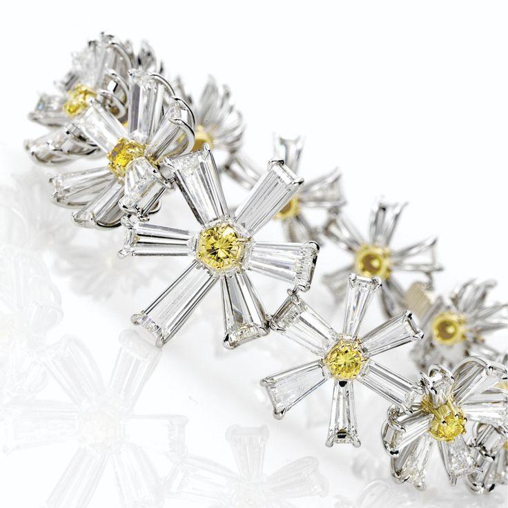 DIAMOND 'LOTUS' BRACELET, WILLIAM GOLDBERG. Designed as a slightly gradu...