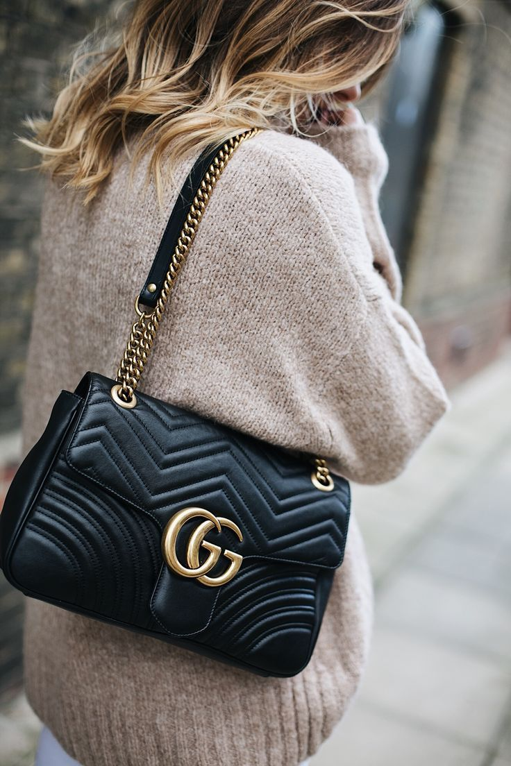 Beige chunky sweater, medium black leather Gucci Marmont Matelasse bag, balayage...
