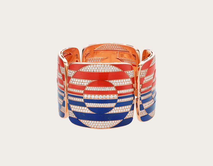 In a perfect combination of round and sharp shapes, the bold bracelet boasts a j...