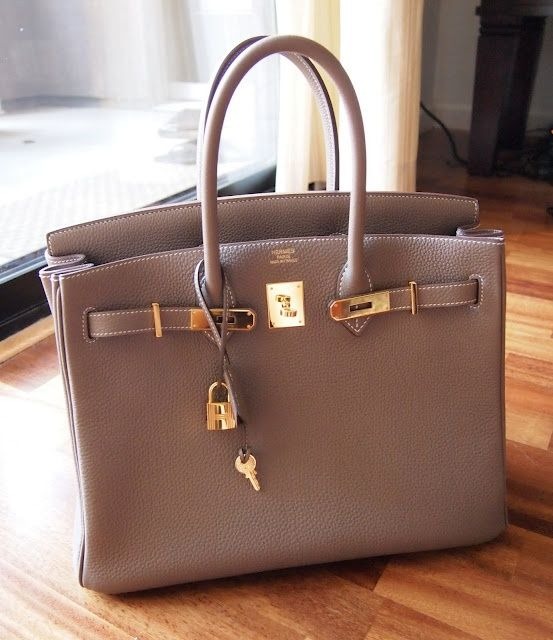 Hermes Birkin in Etoupe w/ gold hardware.  At some point in my adult life I want...