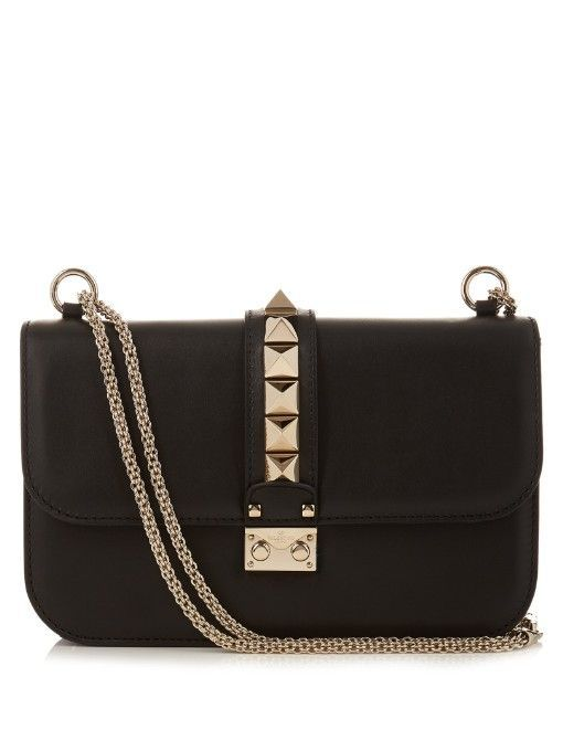 Valentino's black calf-leather Lock bag is a signifier of modern luxury. The...