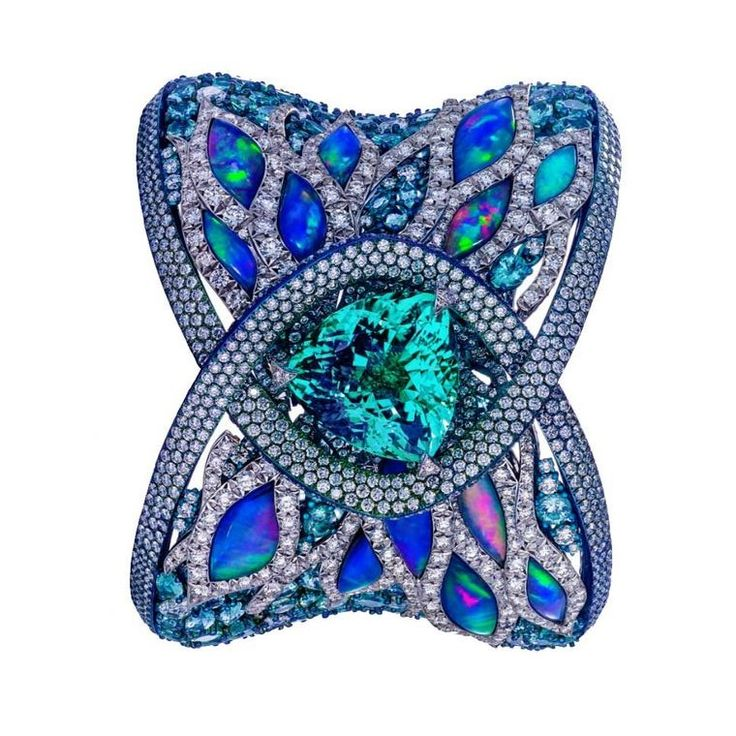 Arunashi Paraíba tourmaline cuff close-up The electric blue 23ct Paraíba tourm...