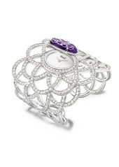 Secret cuff watch in 18K white gold set with 1 hand- engraved stone and 601 bril...