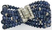 An Art Deco sapphire and diamond bracelet by Cartier. The five rows of graduated...