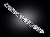 This extraordinary Art Deco bracelet combines intricately pierced geometric plaq...