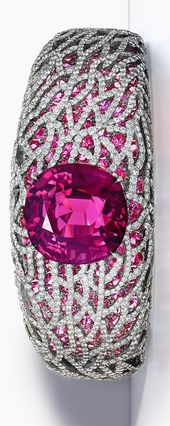A magnificent rubellite is surrounded by a sea of pink sapphires and diamonds in...