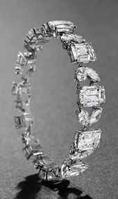 A MAGNIFICENT DIAMOND BRACELET, BY VAN CLEEF & ARPELS Set with eleven rectangula...