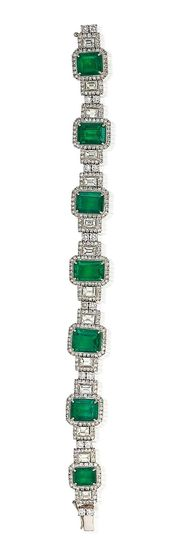An emerald and diamond bracelet The articulated bracelet formed as a graduated s...