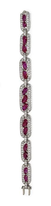DIAMOND AND CARVED RUBY BRACELET AND RING, CIRCA 1930. The bracelet set with old...