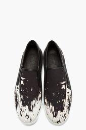 Black textile and leather white-splattered slip-ons