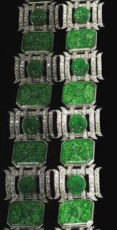 A jadeite jade, diamond and platinum bracelet the link bracelet featuring floral...