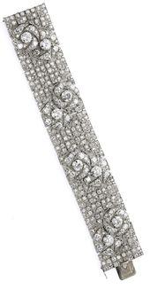 Art Deco diamond bracelet with pattern of stylized roses. By Boucheron, circa 19...