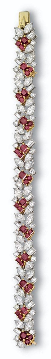 RUBY AND DIAMOND BRACELET, CARTIER. The stylized foliate motif set with 12 pear-...